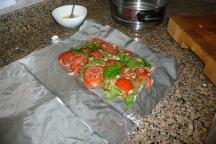A nice bed of; basil, tomato, onion, garlic and balsamic vinegar