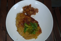 Schnitzel with watercress and spiced apple sauce.